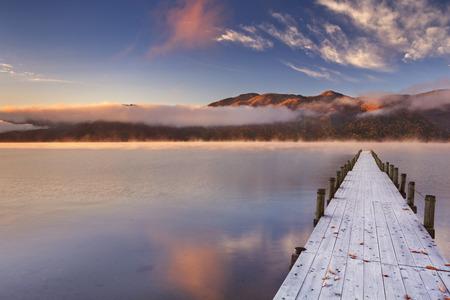Photo for Lake Chuzenji Chuzenjiko,  near Nikko in Japan. Photographed on a beautiful still morning in autumn at sunrise. - Royalty Free Image