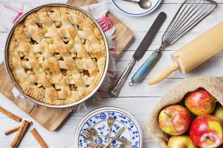 Photo for Homemade Dutch apple pie and ingredients on a rustic table. Photographed from directly above. - Royalty Free Image
