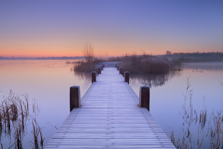 Photo for A quiet lake in The Netherlands with a boardwalk on an early morning. - Royalty Free Image