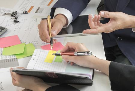 Photo pour Business concepts,Management is executing the secretary is taking notes.Document placed on the desk. - image libre de droit