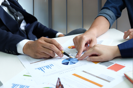 Photo for Businessteam are analyzing graph data.They point at graphs on the desk. - Royalty Free Image