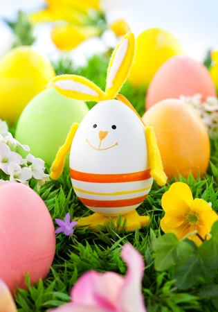 Photo for colorful Easter Eggs and rabbit on the grass - Royalty Free Image