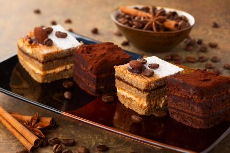 Photo for Coffee cream  small cakes and chocolate truffle cakes - Royalty Free Image