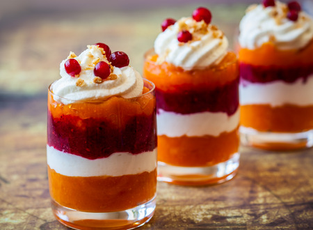 Photo for Layered pumpkin and cranberry dessert with cream - Royalty Free Image