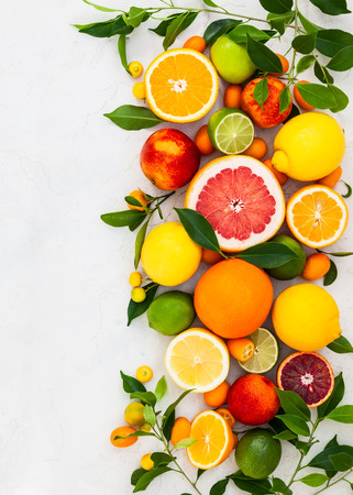 Photo for Assorted fresh citrus fruits with leaves - Royalty Free Image