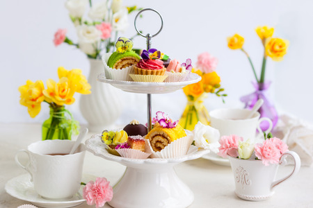 Photo for Assorted cakes and pastries on a cake stand for afternoon tea - Royalty Free Image