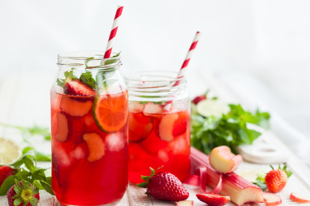 Foto de Preparation homemade refreshing  strawberry,lime and rhubarb lemonade with mint - Imagen libre de derechos