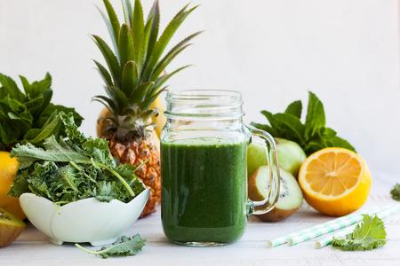 Foto de Fresh kale fruit smoothie in a jar with ingredients - Imagen libre de derechos