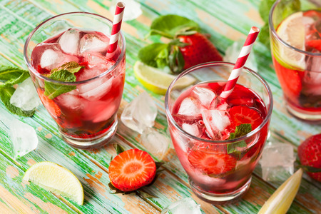 Foto de Refreshing summer drink with Strawberry in jug and glasses on the vintage wooden table - Imagen libre de derechos