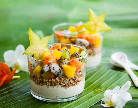 Photo for Healthy breakfast with exotic fruits, yogurt and granola - Royalty Free Image