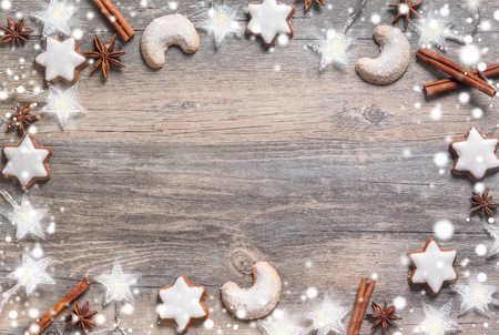 Photo for Christmas background with gingerbread cookies,christmas lights and spices on the old wooden board. Image in cool vintage tone - Royalty Free Image
