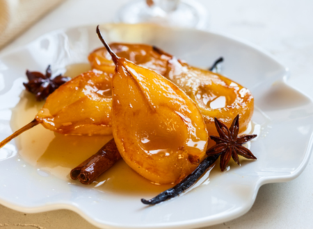 Photo for Poached pears with spices in syrup on the white plate. Delicious dessert for holiday - Royalty Free Image