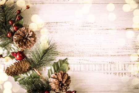 Photo for Christmas background with fir branches, pinecones and berries on the old wooden board in vintage style - Royalty Free Image