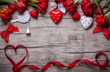 Foto de Valentines Day background with chocolates, hearts and red tulips - Imagen libre de derechos