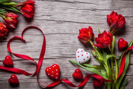 Photo for Valentines Day background with chocolates, hearts and red tulips - Royalty Free Image