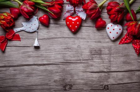 Foto de Valentines Day background with chocolates, hearts and red tulips - Imagen libre de derechos