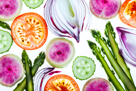 Photo pour Thin slices of fresh vegetables on a white background - image libre de droit