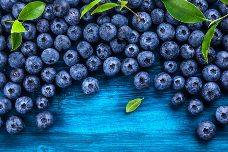 Photo for Fresh blueberry with drops of water on blue wooden background. Top view. Concept of healthy and dieting eating - Royalty Free Image