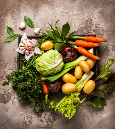 Photo for Variety of fresh raw vegetable ingredients for cooking of vegetable soup or stew. Autumn vegetable still life on rustic vintage background. Top view - Royalty Free Image