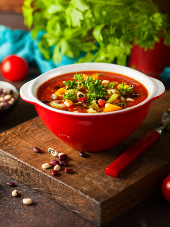 Photo for White and red bean soup with vegetables and tomatoes. Vegetarian bean soup for fall and winter season - Royalty Free Image