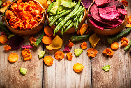 Photo for Dried vegetables chips from carrot, beet, parsnip and other vegetables . Organic diet and vegan food. - Royalty Free Image