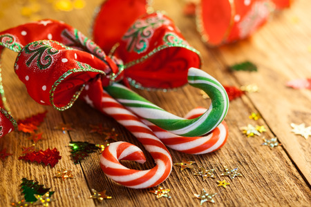 Photo for Christmas Candy canes with a gift ribbon on the wooden background - Royalty Free Image