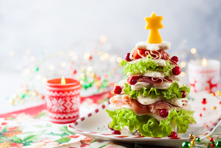 Photo for Christmas tree from toasted bread, lettuce, ham and cheese. Festive idea for Christmas or New Year dinner. - Royalty Free Image