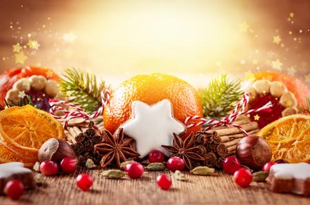 Foto de Christmas decoration with mandarins,cookies,berries and spices - Imagen libre de derechos
