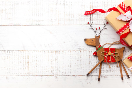 Photo for Christmas decoration and gift boxes on white wooden background. - Royalty Free Image