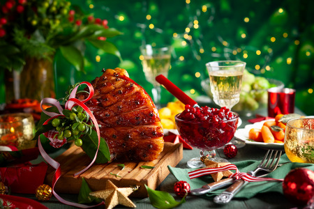Photo for Glazed roast ham with cloves,sparkling wine and traditional vegetables dishes for Christmas dinner. - Royalty Free Image