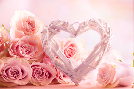 Foto de Festive still life with pink roses and wooden heart. - Imagen libre de derechos