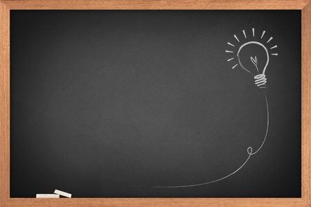 Photo for Drawing of a bulb idea on blackboard  - Royalty Free Image