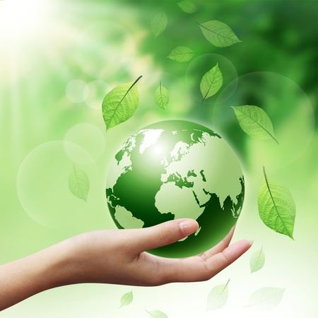 woman hands holding green earth with a leaf