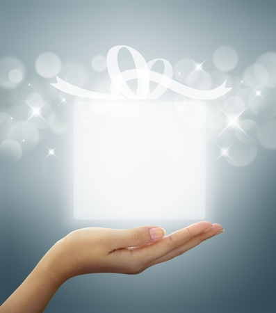 Photo for gift box Translucent white on woman hand  - Royalty Free Image
