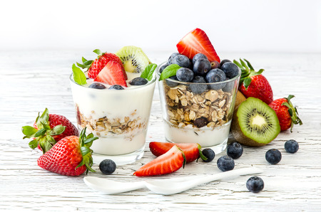 Foto de Granola or muesli with berries and fruits for healthy morning meal - Imagen libre de derechos