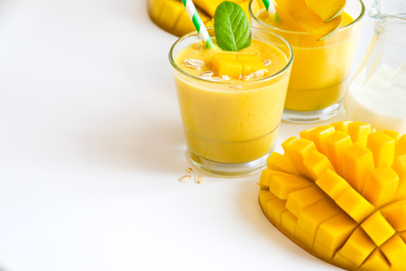 Foto de Healthy drink with yogurt and mango sample text background - Imagen libre de derechos