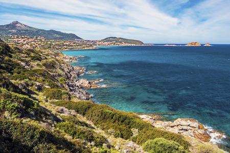 Foto de Coastline landscape in approach Ile-Rousse city in Corsica Island, seen at background with Pietra islet at right, Haute-Corse, France - Imagen libre de derechos