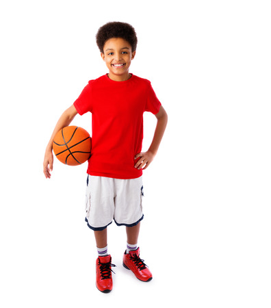 Photo pour African American smiling teenager, basketball player posing with a ball in his hand isolated on white. Full body portrait.  - image libre de droit