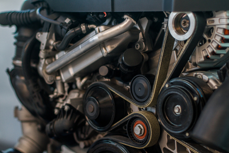 Photo pour Modern car clean look engine with timing and serpentine belts - image libre de droit