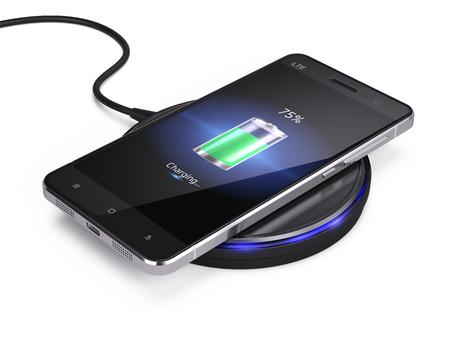 Photo pour Wireless charging of smartphone isolated on white background - image libre de droit