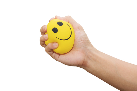 Foto de Hand squeeze yellow stress ball, isolated on white background, anger management, positive thinking concepts - Imagen libre de derechos