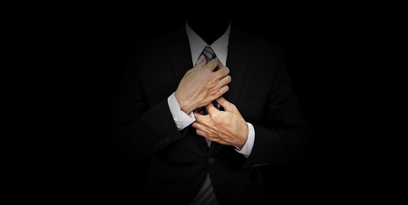 Foto de Businessman in black suit on panoramic black background - Imagen libre de derechos