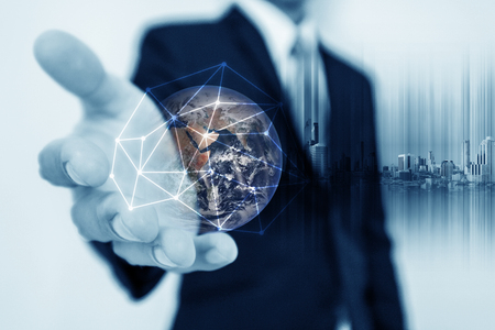 Photo pour Businessman holding globe hologram with network connection lines. Global business networking, currency exchange and travel around the world concept. - image libre de droit