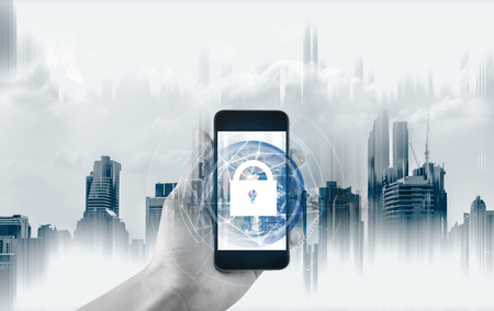Photo pour Mobile device security and internet connection . Hand using mobile smart phone and lock icon. - image libre de droit