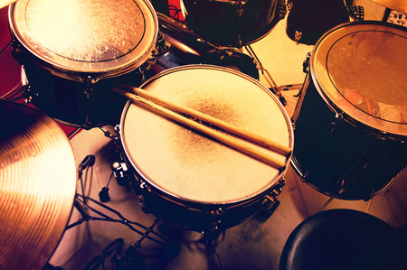 Photo for Drums conceptual image. Picture of drums and drumsticks lying on snare drum. Retro vintage instagram picture. - Royalty Free Image