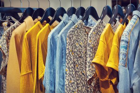 Photo pour A row of clothes hanging on the rack - image libre de droit