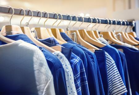 Foto de A row of clothes hanging on the rack - Imagen libre de derechos