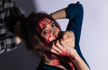 Photo pour Sexual abuse with a man attacking to a scared woman in a dark place. - image libre de droit