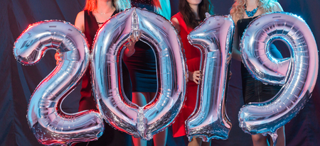 Photo for New Year party concept. Close up of young women holding silver colored numbers 2019 - Royalty Free Image