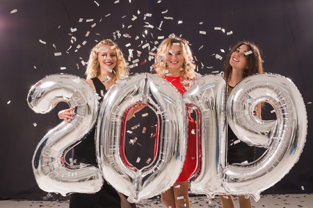 Photo for Party, holidays and people concept - Group of female friends celebrating New Year holding big 2019 symbol - Royalty Free Image